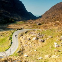 Curvy road heading towards the narrow Gap of Dunloe, Ireland